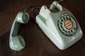 Old Green Vintage Telephone, Phone Land  Or Landline With Dust On Wooden Retro Desk. Vintage Desk Te poster