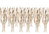 Large group of wooden dummies forming a crowd on white
