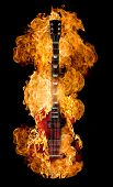 Burning electric guitar on black background