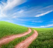 stock photo of dirt road  - beautiful dirt road and meadow - JPG