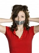 Teenage girl's mouth covered by duct tape