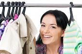 Постер, плакат: Shopaholic shopping woman with clothes rack isolated on white background