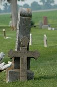 pic of life after death  - An old dutch grave marker leans against another stone where it was propped after breaking - JPG