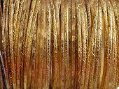 close up of gold bracelets