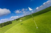 View Of A Green Golf Course, Hole And Flag On A Bright Sunny Day. Sport, Relax, Recreation And Leisu poster