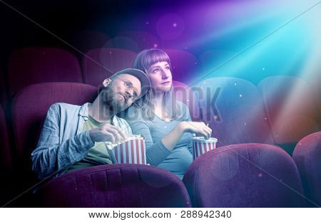 Teenager couple cuddling and watching