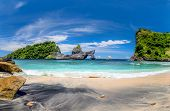 View of idyllic tropical beach with small island and perfect azure clean water - nobody / Indonesia, poster