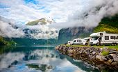 Camper van recreational vehicles (RV) parked at norwegian campsite on a fjord coast, Norway, Scandin poster