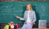 Teacher With Alarm Clock At Blackboard. Time. Study And Education. Modern School. Knowledge Day. Wom poster