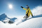 stock photo of snowboarding  - Young snowboarder in deep powder  - JPG