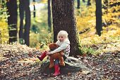 Active Little Girl With Teddy Bear In Autumn Forest. Active Rest And Activity On Fresh Air In Woods poster