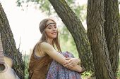 Beautiful Hippie Girl Sitting Near Trees In Forest poster