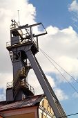 Coal mine headgear tower on blue sky