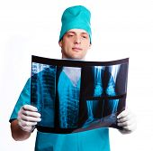 portrait of a surgeon looking at the x-ray photograph, isolated against white background