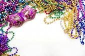 stock photo of carnivale  - mardi gras mask and beads for party - JPG
