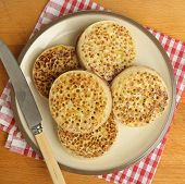 Plate of hot buttered crumpets