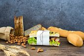 Sandwich Sandwich With Ham Fresh Green Lettuce Red Tomatoes Have French Bread Almonds In Sacks And W poster