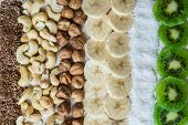 Fresh Ingredients For A Healthy Raw Food Breakfast. Kiwi, Coconut Flakes, Cashews And Hazelnuts Shot poster