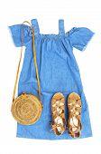 Stylish Trendy Feminine Summer Clothing Denim Dress Sundress, Sandals Round Rattan Bag On White Back poster