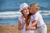 Happy Family At Sea Summer. Little Boy Son Hugs And Kisses Mother. Child Loves Mom. Portrait Young W poster