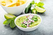 Guacamole With Red Onion And Jalapeno Pepper In A White Bowl With Chips poster