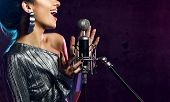 Beautiful Singing Girl Curly Afro Hair. Beauty Woman Singer Sing With Microphone Karaoke Song On Sta poster