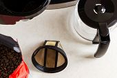 Basket Coffee Filter, Drip-type Coffee Maker And Coffee Beans On The Kitchen Table, Top View. Reusab poster