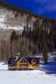 Colorado Mountain Log Home In Snow