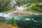 Beautiful Waterfall In The Valley Of Waterfalls In Norway. Husedalen Waterfalls Were A Series Of Fou poster