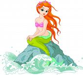 stock photo of mermaid  - Beautiful mermaid girl sitting on the rock - JPG