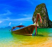 Summer beach tropical landscape. Thailand island scenic background, azure water, traditional long ta