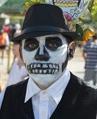 OCEANSIDE, CALIFORNIA - OCTOBER 28: An unnamed man with a painted face at the Dia De Los Muertos