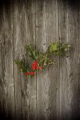 Old wooden background with christmas inducement paint