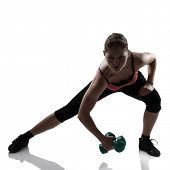 sport young athletic woman lunges with dumbbells, silhouette studio shot over white background