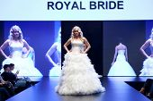 ZAGREB, CROATIA - OCTOBER 27: Fashion model in wedding dress walks on the catwalk during the Zagreb