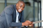 handsome african american business executive with smart phone