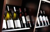 picture of liquor bottle  - Wine bottles on a wooden shelf - JPG
