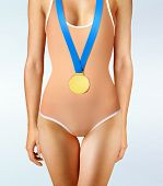 Part of beautiful winner wearing gold medal