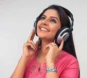Wearing A Headphone And Listening To Music