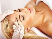 foto of collagen  - Beauty woman giving botox injections - JPG