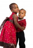 Little African American Sister and Bother Hug Each Other on White Background