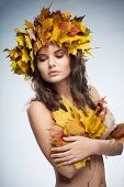 Beautiful woman autumn leafs.