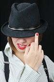 image of indecent  - nice woman show incecent sign on black background - JPG
