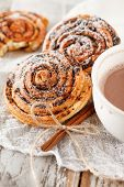 stock photo of desert christmas  - cinnamon rolls with cocoa - JPG