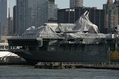 NEW YORK - NOV 1: The Space Shuttle Enterprise lays on the USS Intrepid on November 1, 2012 in New York City. The Enterprise is partially draped after Hurricane Sandy hit the area on October 29, 2012.