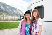 Young womans in front of motorhome
