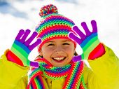 Winter fun, kid winter playing - lovely girl has a fun in snow