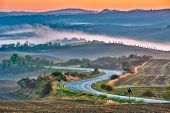 stock photo of farmhouse  - Tuscany landscape at sunrise - JPG