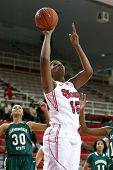 NEW YORK-NOV 3: St. John's Red Storm center Jennifer Blanding (15) shoots against the Farmingdale Rams at Carnesecca Arena on November 3, 2012 in Jamaica, Queens, New York.
