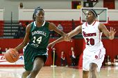 NEW YORK-NOV 3: Farmingdale Rams guard Siohban Purvis dribbles past St. John's Red Storm guard Keyla